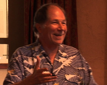 Jim smiles happily: he really enjoys teaching stand-up comedy!